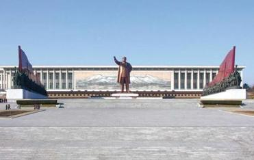 A colossal statue of the Great Leader, Kim Il Sung, dwarfs visitors to the Grand Monument on Mansu Hill.